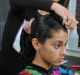 Girl Getting Strand By Strand Lice Removal